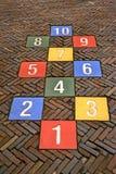Färga numrerar stenmångfald på vägen, reser, Arkivbilder