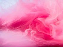 färgad abstrakt bakgrund Rosa färger röker, färgpulver i vatten, modellerna av universumet Abstrakt rörelse som frysas Royaltyfria Bilder