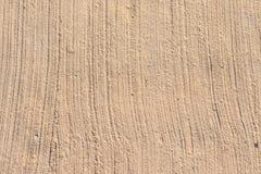 Färgad bakgrundsdesign för cement beiga Royaltyfri Bild