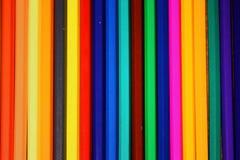 F?rgade blyertspennor ror bakgrund/textur royaltyfri foto