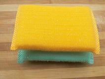 Färgade guling och aqua skurar block Fotografering för Bildbyråer