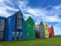 färgade hus Arkivfoton
