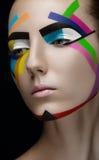 Färgade linjer för flicka makeup royaltyfri bild