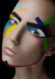 Färgade linjer för flicka makeup fotografering för bildbyråer