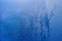 Färgar abstrakt textur fryste vattendroppar av blått Arkivfoto