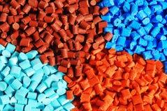 färgat granulate plast- royaltyfri foto