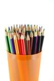 Färgblyertspennor i den orange stöttan Royaltyfri Foto