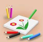 Färgblyertspennor och bild Arkivbilder