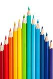 Färgblyertspennor som ett maximum eller pilar Arkivfoton