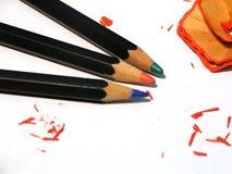 färgblyertspennor tre Royaltyfria Bilder