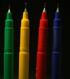 färger fyra pennor royaltyfri fotografi
