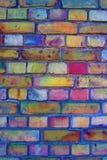Färgglad tegelstenvägg Arkivfoto