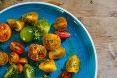Färgglad tomatsallad Fotografering för Bildbyråer