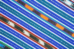 färgglad traditionell textilmodellcloseup i Guatemala Fotografering för Bildbyråer