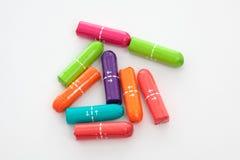 färgglada kvinnliga hygientamponger Royaltyfria Bilder