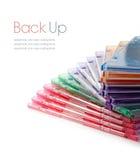 Färgglada staplade DVD-fall arkivbilder