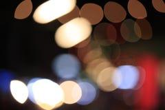 Färgglade defocused ljus på mörker Fotografering för Bildbyråer