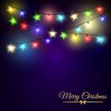 Färgglade glödande julljus på mörk bakgrund Arkivbild