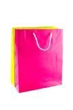 Färgglade pappers- isolerade shoppingpåsar Royaltyfri Foto