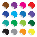 Färgglade runda klistermärkear på vit bakgrund Arkivbild
