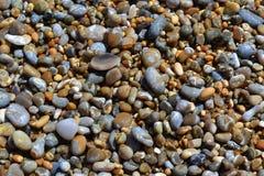 Färgglade strandkiselstenar Royaltyfria Bilder