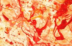 Färgglat handgjort papper i guling-röda signaler på den vita bakgrunden Royaltyfri Fotografi