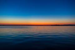 Färggradering av solnedgången på sjön Kasumigaura Arkivbild