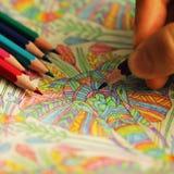 Färgläggningboken med blyertspennor Fotografering för Bildbyråer