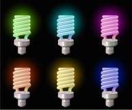 färglightbulben sparar seten Arkivbild