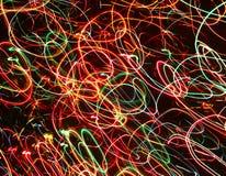 Färgneonstrimmor av ljusa glödlinjer Arkivbilder