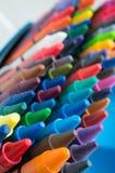 Färgpenna i asken Arkivfoto