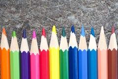 Färgpenna på wood bakgrund Royaltyfria Bilder