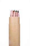 Färgpennor i en pappers- cylinder Royaltyfri Bild