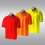färgpoloskjortor t royaltyfri fotografi