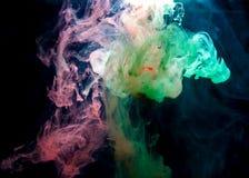 Färgpulver i vatten. Fotografering för Bildbyråer