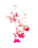 Färgpulver i vatten Arkivbilder