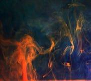 Färgpulver i vatten, färgabstraktion Royaltyfri Foto