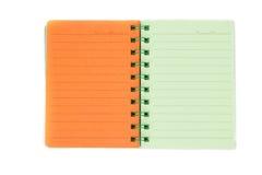 färgrik anteckningsbok Arkivfoto