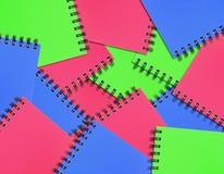 färgrik anteckningsbok för bakgrund Arkivbild
