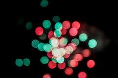 Färgrik bakgrund för fyrverkeriexplosionBokeh partiklar arkivfoton