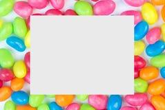 Färgrik bakgrund för geléböna med utrymme för vit fyrkant för text Arkivbild