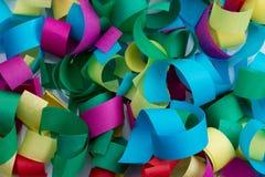 Färgrik bakgrund för pappers- konfettiar Arkivbild