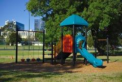 Färgrik barnlekplatsutrustning arkivfoton