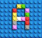 Färgrik bokstav A från byggnadslegotegelstenar på blå legobakgrund Lego bokstav M Royaltyfria Bilder