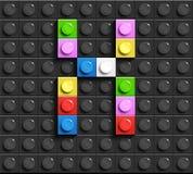 Färgrik bokstav X från byggnadslegotegelstenar på svart legobakgrund Lego bokstav M Royaltyfria Foton