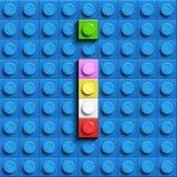Färgrik bokstav I från byggnadslegotegelstenar på blå legobakgrund Lego bokstav M Royaltyfri Foto