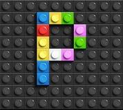 Färgrik bokstav P från byggnadslegotegelstenar på svart legobakgrund Lego bokstav M Royaltyfria Foton