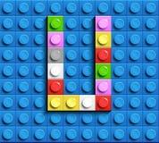 Färgrik bokstav U från byggnadslegotegelstenar på blå legobakgrund Lego bokstav M Royaltyfria Foton