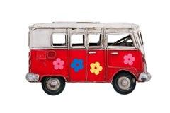 Färgrik buss för Toy av metall fotografering för bildbyråer