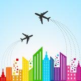 Färgrik cityscapeplats med flygplanet Arkivbild